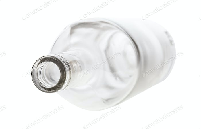 overturned empty clear bottle isolated on white