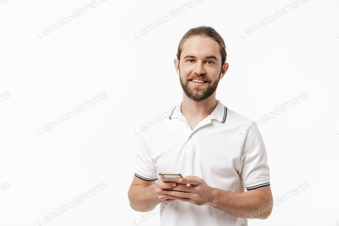 Handsome bearded man using mobile phone.