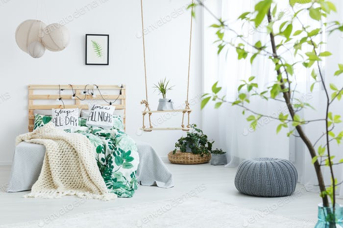 Bedroom with gray pouf