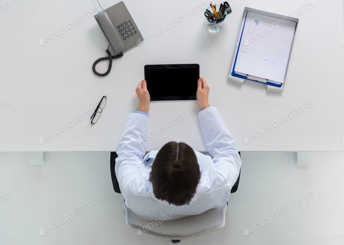 doctor with tablet pc at clinic