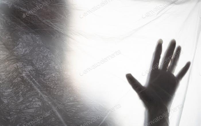 Silhouette einer Hand von Coronavirus covid 19