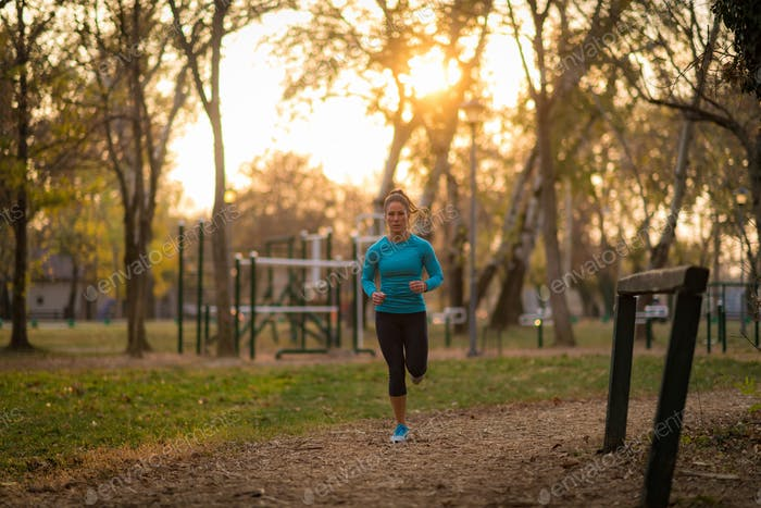 Woman Jogging Outdoors in the Park