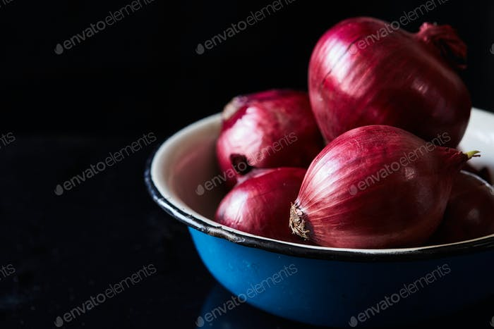Sliced red spanish onion on vintage ceramic bowl