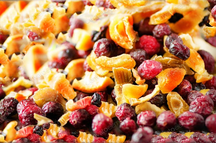 Sweet mix dried fruits on stone. Cranberry, rhubarb, apple, mango, cherry, peach, apricot. High dose
