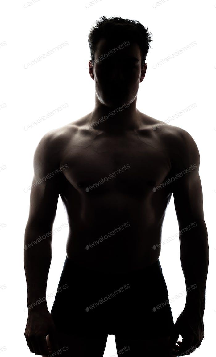 Muscular man in silhouette