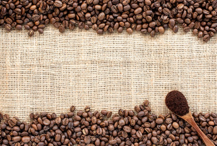 Coffee beans on sackcloth for background.