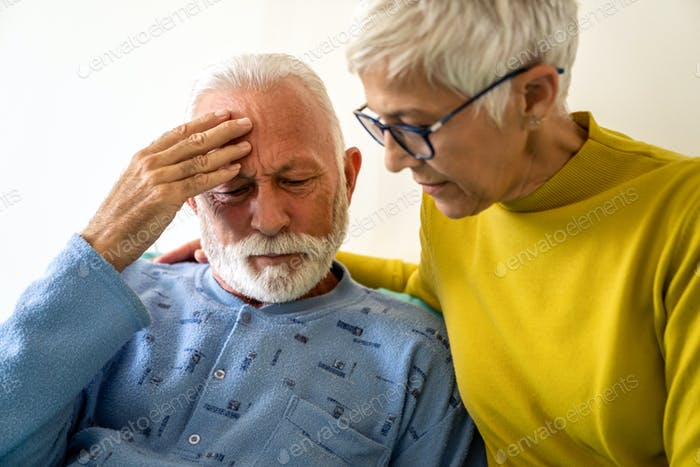 Senior woman with seriously ill husband in hospital. Healthcare support anxiety love concept