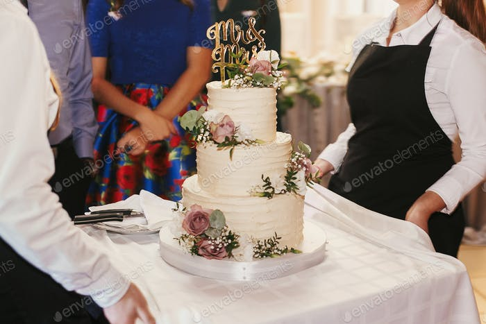 Modern wedding cake at wedding reception