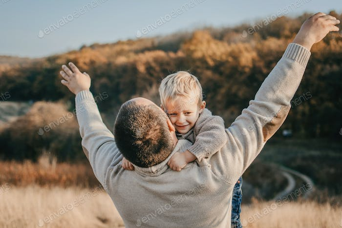 Father's day, Happy loving family. Father and son playing, having fun on the nature. Happy