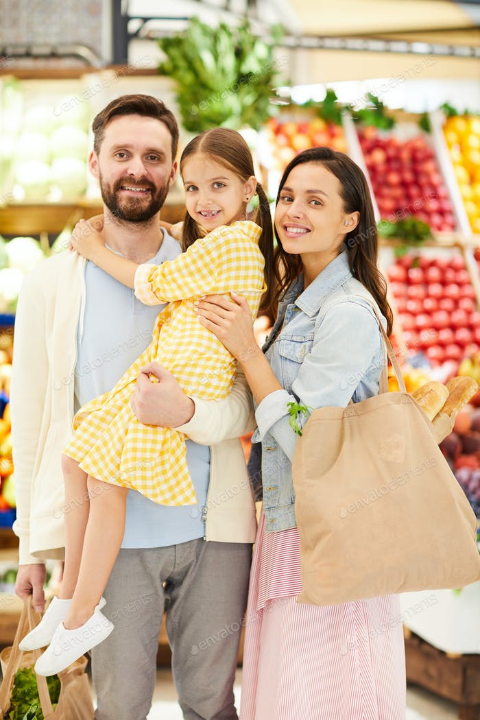 Optimistic young family enjoying shopping together