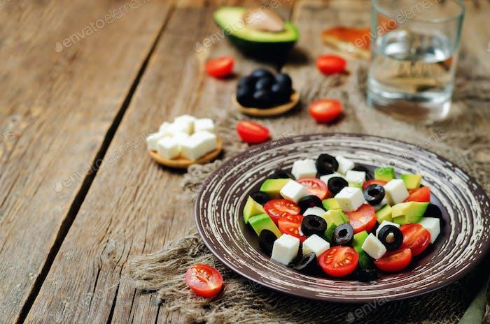 Avocado tomato black olives feta cheese salad
