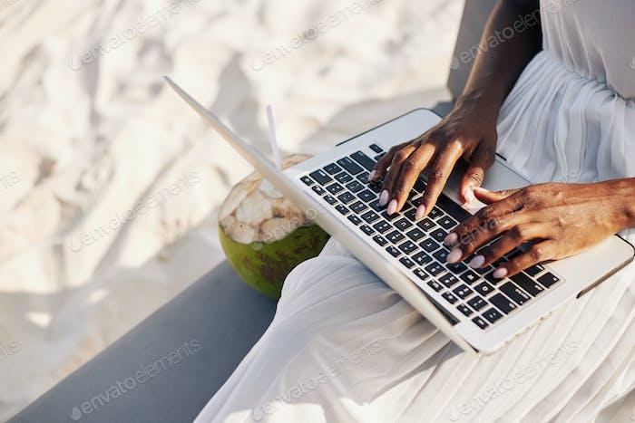 Working on sandy beach