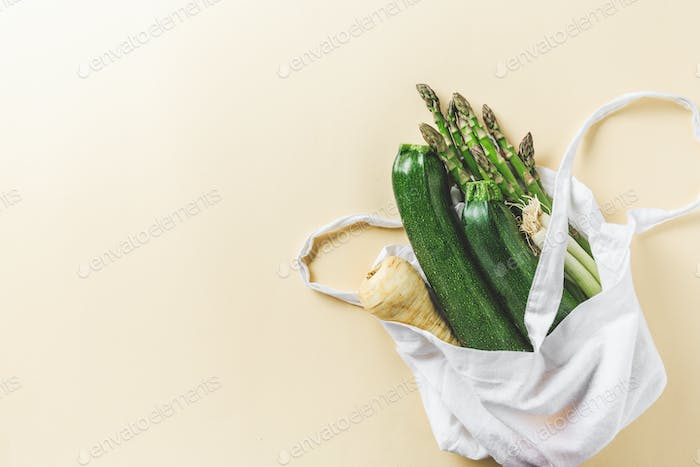 Different vegetables in textile bag on grey