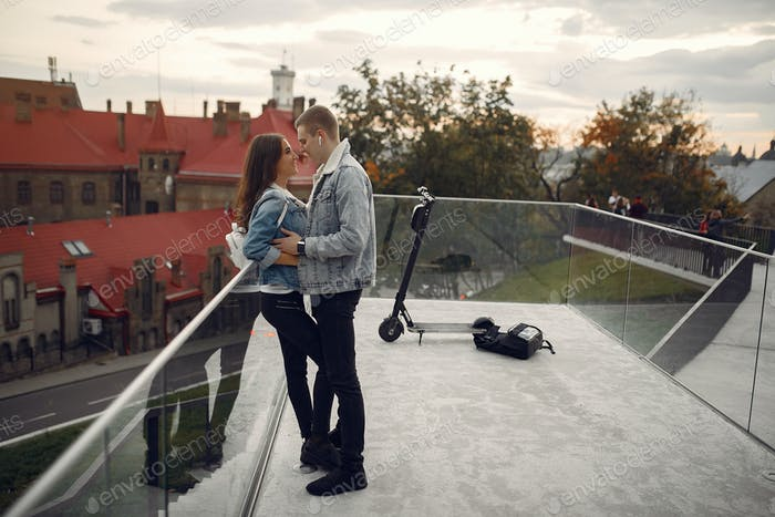 Beautiful couple spend time in a autumn city
