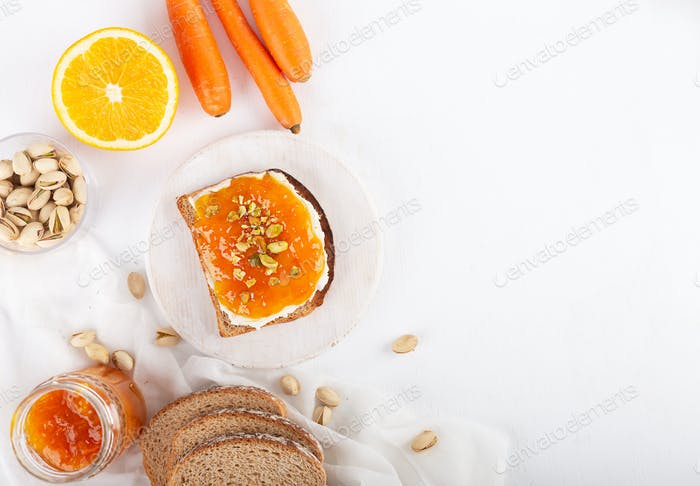 Carrot Jam with orange juice on a gray background
