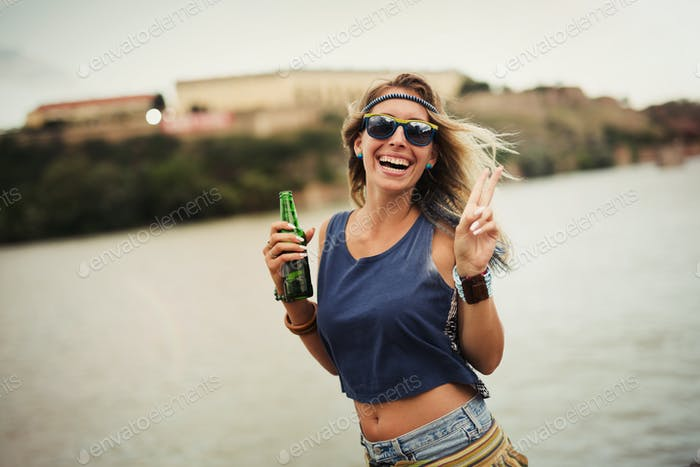Beautiful blond woman partying and enjoying freedom