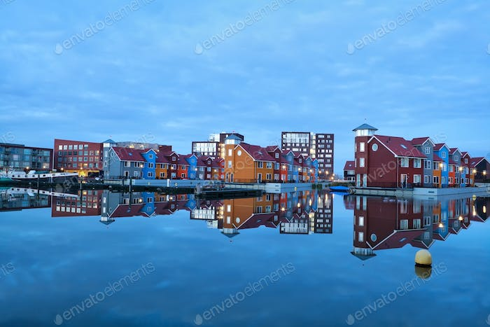 colorful buildings on water at marina Reitdiephaven