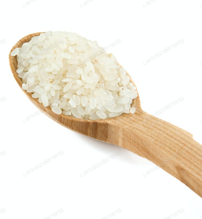 rice grain in wooden spoon isolated on white