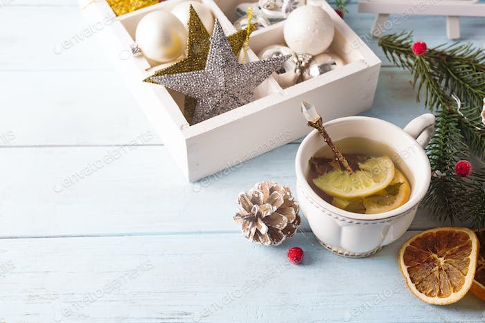 Hot green tea with lemon on a wooden table