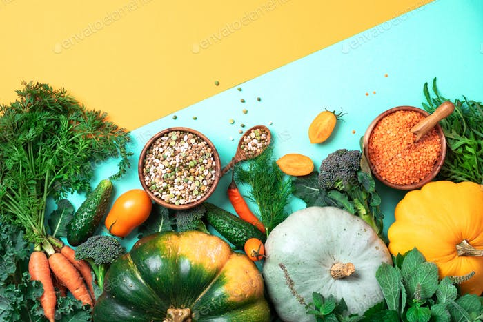 Organic vegetables, lentils, beans, raw ingredients for cooking on trendy yellow and green