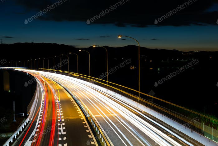 Light trails cars highway
