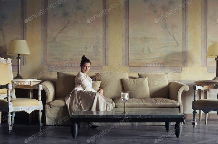 Girl sitting on a sofa