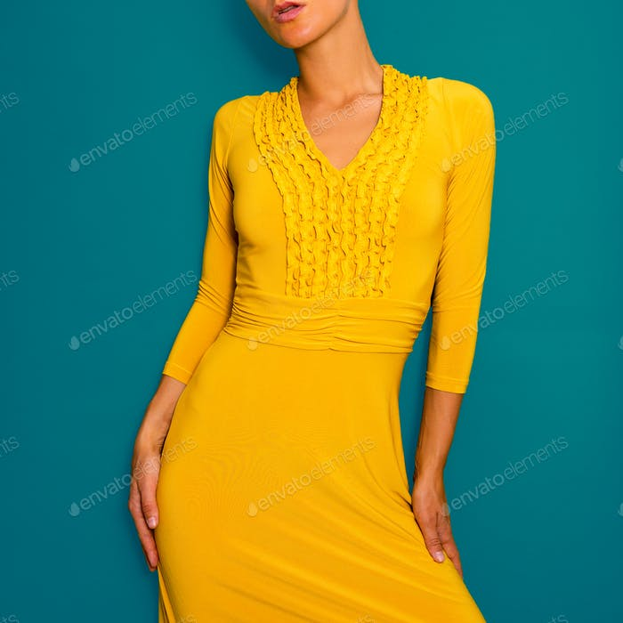 Lady in a yellow vintage dress. Retro fashion chic