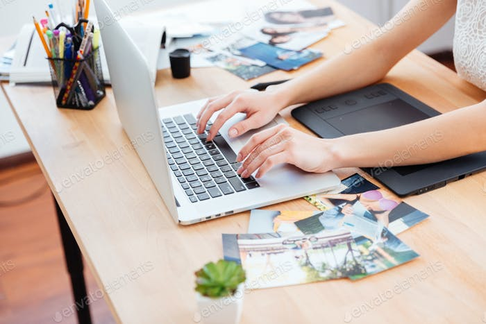 Thumbnail for Woman photograper typing on laptop keyboard and using graphic tablet