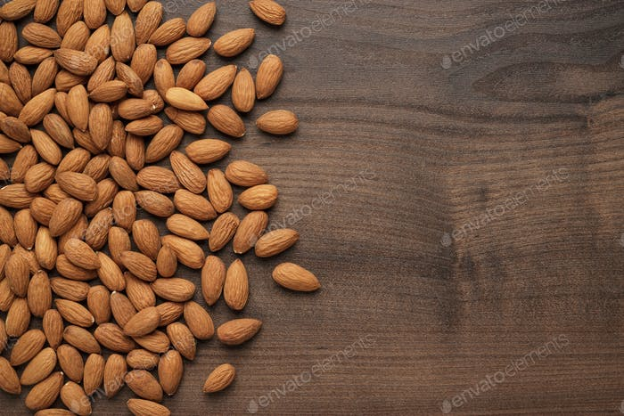 Almond Seeds On The Table Background