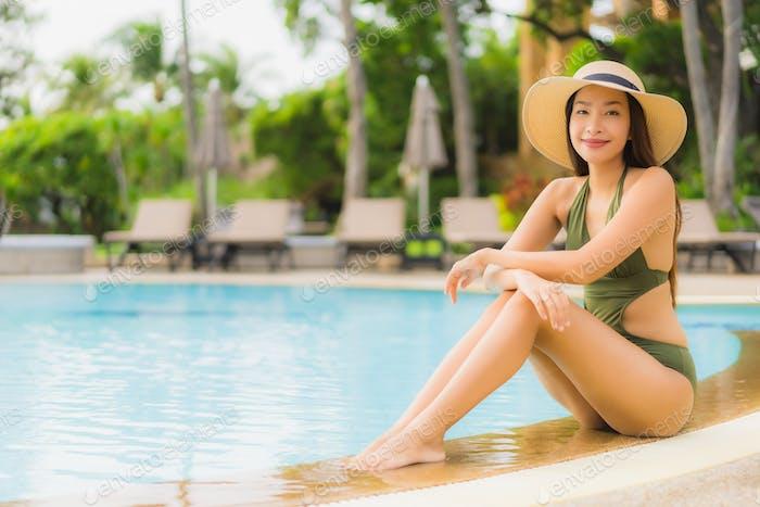 Portrait beautiful asian women happy smile relax around swimming