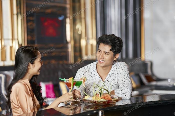 Couple In Modern Hotel Saloon