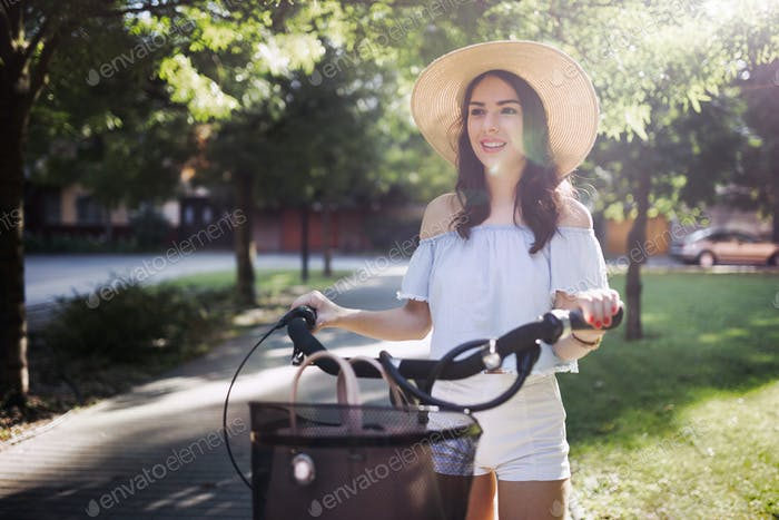 Portrait of beautiful woman enjoying time on bicycle
