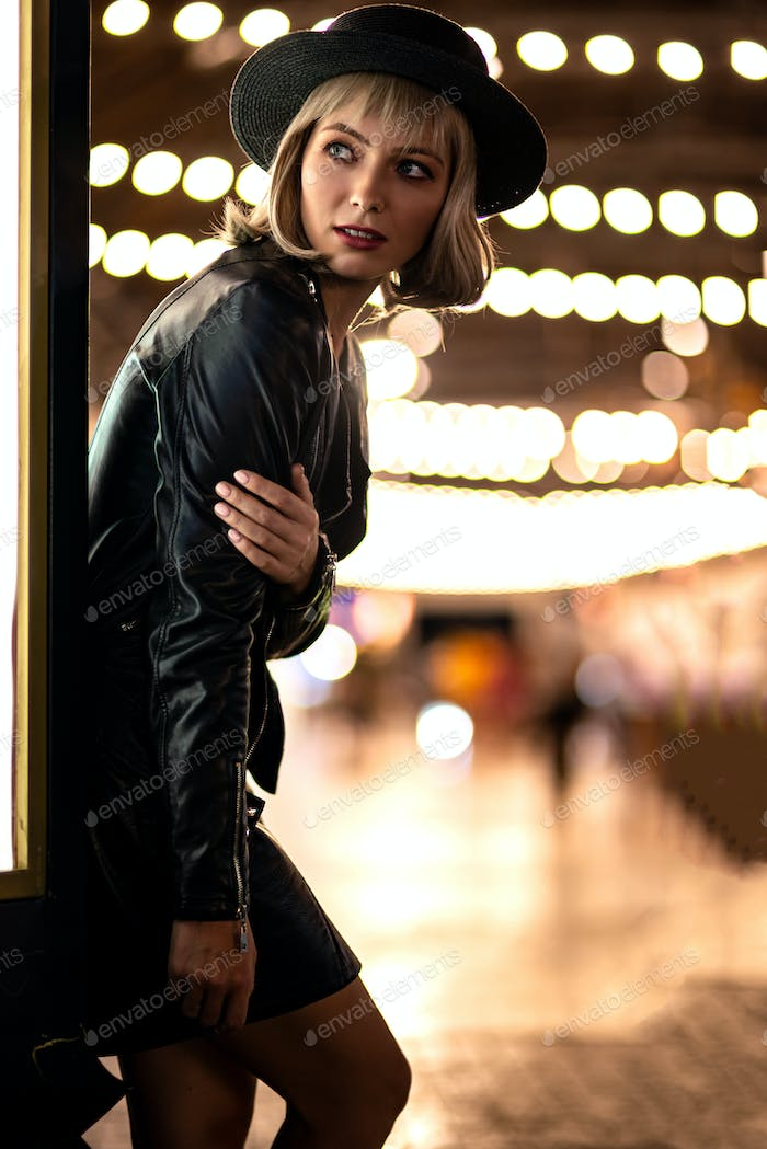 Catch me if you can. Beautiful mysterious woman exploring night city alone.