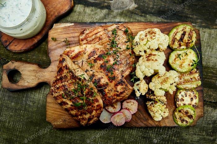 Steak turkey grill on wooden cutting board