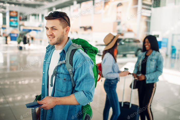 Male tourist holds passport in airport