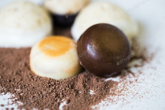 Delicious chocolate candies on white background. Food