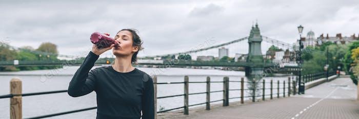 Woman is running in urban area