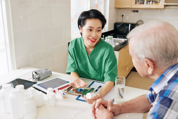 Medical nurse visiting senior patient
