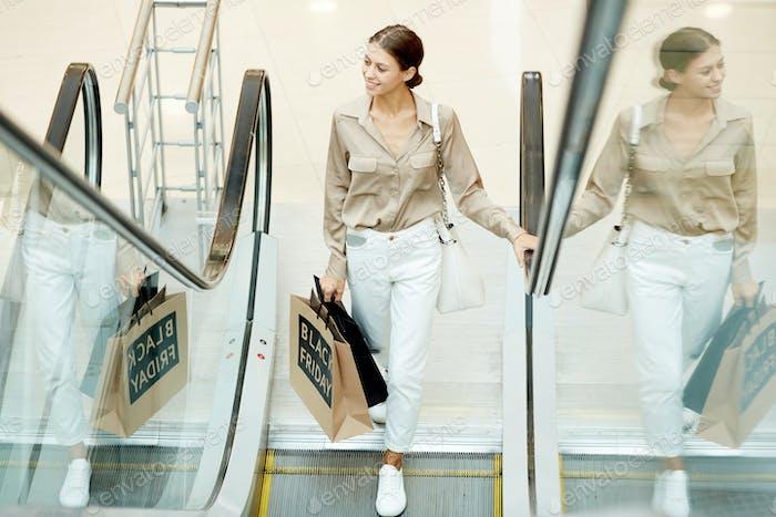Woman on the escalator