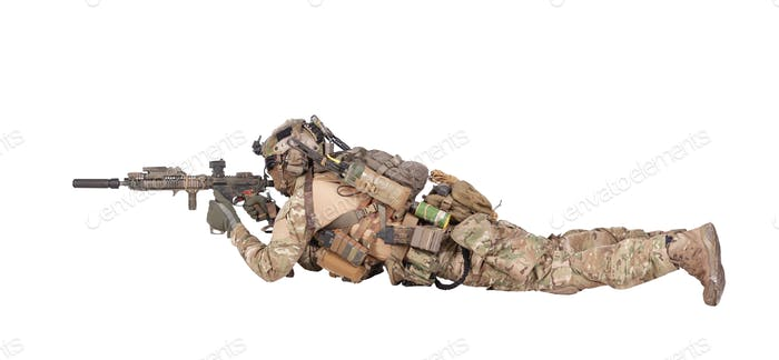 Soldier shooting from ground isolated studio shoot