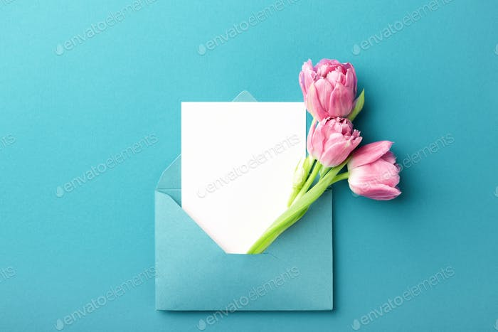 Three Pink Tulips and Empty Card in Turquoise Envelope.
