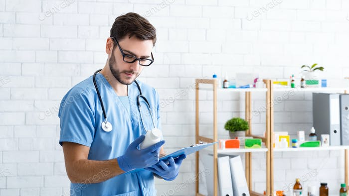 Professional male animal doctor with prescription pills and clipboard at veterinary clinic, blank