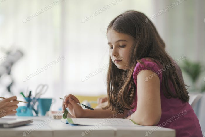 Cute kid studying at home