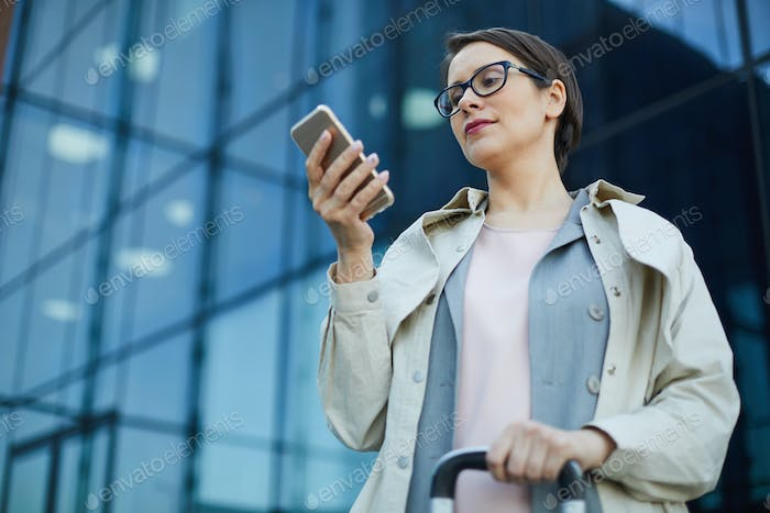Businesswoman reading message on move