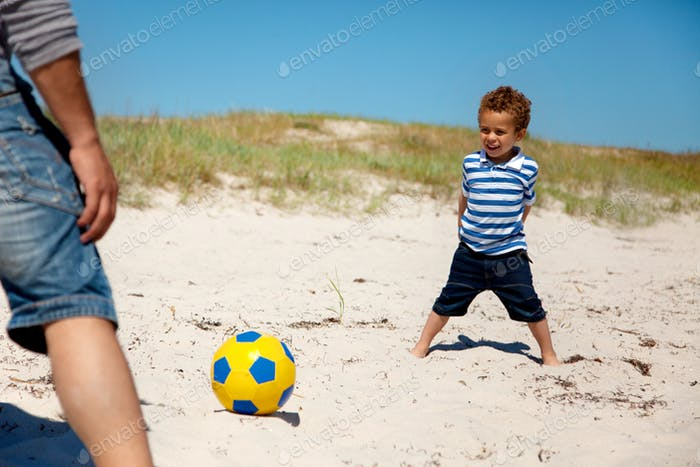 Little Kid Playing Football with Dad