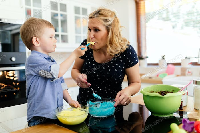 Cute child tasting cookie ingredients