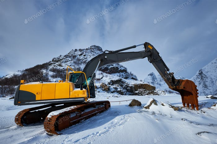 Old excavator in winter