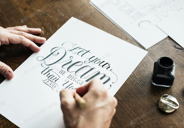 Closeup of a calligrapher working on a project