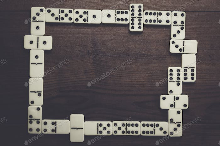 domino pieces on wooden table background
