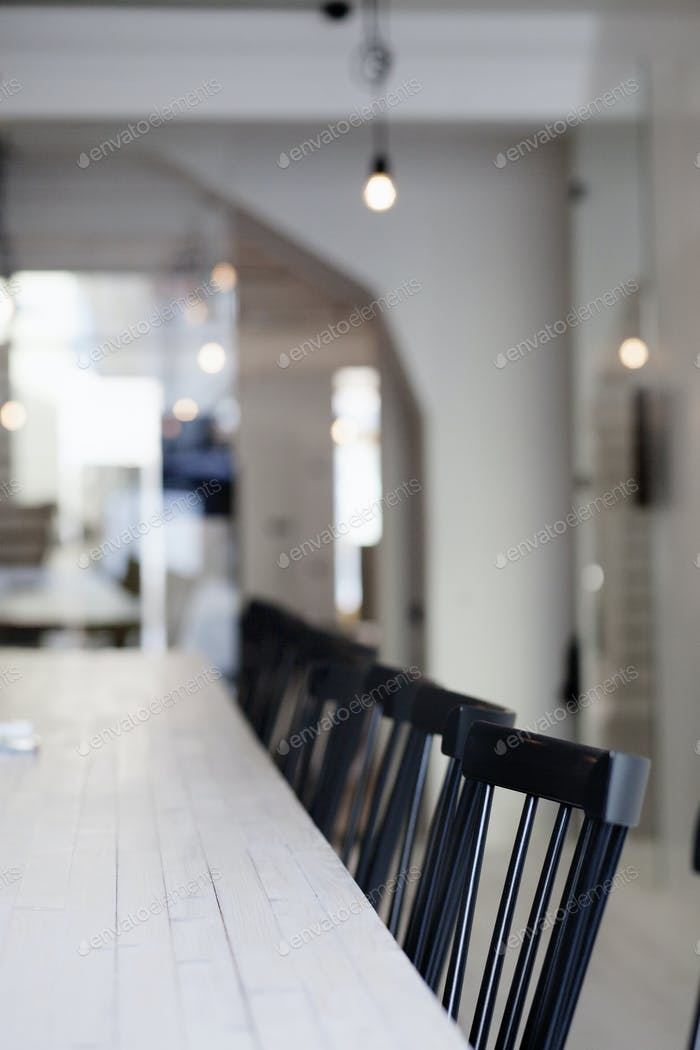 Chairs at dining table
